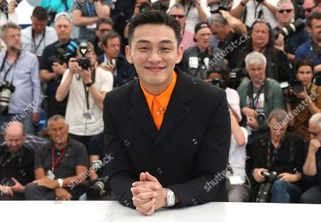 Actor Ah-in Yoo poses for photographers during a photo call for the film 'Burning' at the 71st international film festival, Cannes, southern France