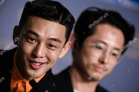 South Korean actor Yoo Ah-In (L) attends the press conference for 'Burning' during the 71st annual Cannes Film Festival, in Cannes, France, 17 May 2018. The movie is presented in the Official Competition of the festival which runs from 08 to 19 May.