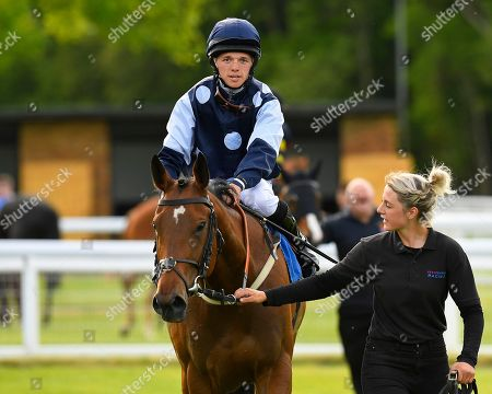 Winner of The Shadwell Stud Racing Excellence Apprentice Handicap Moorovertheridge  ridden by Harry Burns and trained by Grace Harris  is led into the winners enclosure during Afternoon Racing at Salisbury Racecourse on 17th May 2018