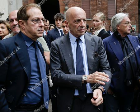 Italian journalist Alessandro Sallusti, center, is flanked by Paolo Berlusconi as they attendthe Italian entrepreneur Salvatore Ligresti's funeral, in Milan, Italy