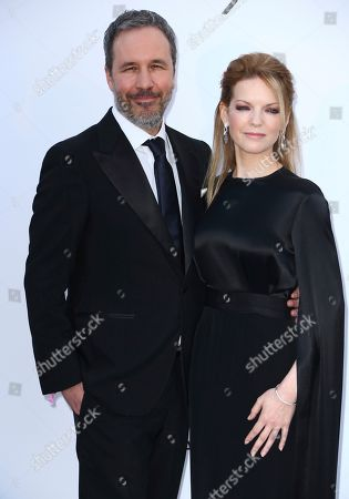 Denis Villeneuve, Tanya Lapointe. Director Denis Villeneuve, left, and Tanya Lapointe pose for photographers upon arrival at the amfAR, Cinema Against AIDS, benefit at the Hotel du Cap-Eden-Roc, during the 71st international Cannes film festival, in Cap d'Antibes, southern France