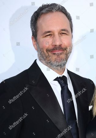 Director Denis Villeneuve poses for photographers upon arrival at the amfAR, Cinema Against AIDS, benefit at the Hotel du Cap-Eden-Roc, during the 71st international Cannes film festival, in Cap d'Antibes, southern France