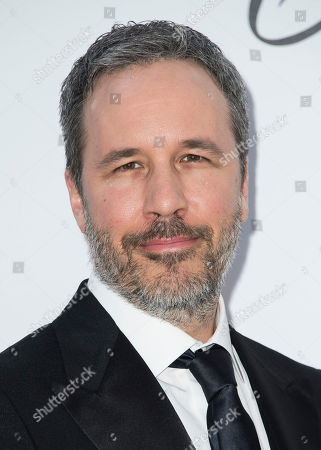 Denis Villeneuve poses for photographers upon arrival at the amfAR, Cinema Against AIDS, benefit at the Hotel du Cap-Eden-Roc, during the 71st international Cannes film festival, in Cap d'Antibes, southern France