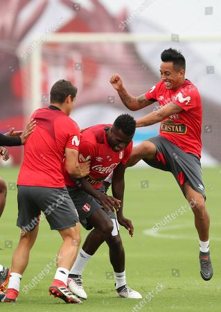 Peruvian soccer players Aldo Corzo (L), Christian Ramos (C) and Christian Cueva (R) joke during a training session at the Villa Deportiva Nacional facilities, in Lima, Peru, 17 May 2018. Peruvian team will play friendly games with Scotland, Saudi Arabia, and Sweden before the Russia 2018 World Soccer Cup.