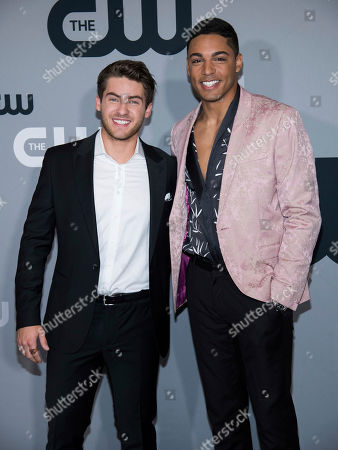 Michael Evans Behling, Cody Christian. Cody Christian, left, and Michael Evans Behling attend The CW Network 2018 Upfront at The London NYC, in New York