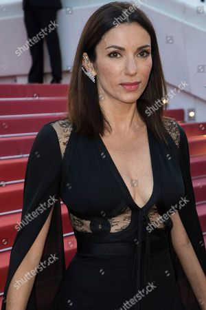 Actress Aure Atika poses for photographers upon arrival at the premiere of the film 'Capharnaum' at the 71st international film festival, Cannes, southern France