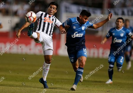 Nestor Gimenez, Gervasio Daniel Nunez. Midfielder Gervasio Daniel Nunez of Argentina's Atletico Tucuman, right, fights for the ball with defender Nestor Gimenez of Paraguay's Libertad during a Copa Libertadores soccer match, in Asuncion, Paraguay