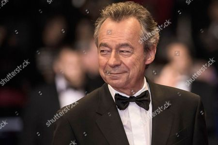 Michel Denisot poses for photographers upon arrival at the premiere of the film 'Knife + Heart' at the 71st international film festival, Cannes, southern France