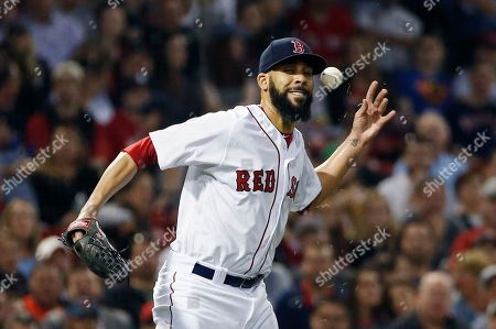 Boston Red Sox's David Price bobbles the ball on a single by Baltimore Orioles' Jonathan Schoop during the fourth inning of a baseball game in Boston
