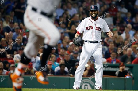 David Price, Jonathan Schoop. Boston Red Sox's David Price reacts after bobbling the ball on a single by Baltimore Orioles' Jonathan Schoop, left, during the fourth inning of a baseball game in Boston