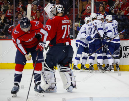 Alex Ovechkin, Alex Killorn, Braden Holtby, John Carson. Tampa Bay Lightning left wing Alex Killorn (17) is surround by his teammates after scoring on Washington Capitals goaltender Braden Holtby (70) during the third period of Game 4 of the NHL Eastern Conference finals hockey playoff series, in Washington. The Lightning won 4-2
