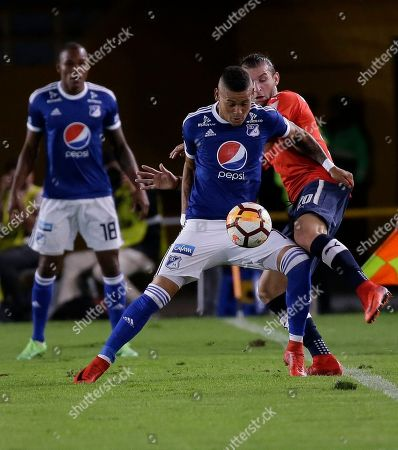 Gaston Silva, Ayron del Valle. Gaston Silva of Argentina's Independiente, right, battles for the ball with Ayron del Valle of Colombia's Millonarios during a Copa Libertadores soccer match in Bogota, Colombia