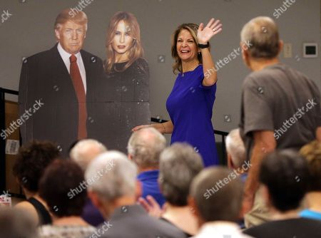 U.S. Senatorial candidate Kelli Ward waves to volunteers and voters as she walks past a cardboard cut-out of President Donald Trump and the first lady Melania Trump during the Sun Lakes Republican Club meeting in Sun Lakes, Ariz. After teacher walkouts, a competitive senate race and a special election that Republicans almost lost in one of the most conservative congressional districts in the nation, Democrats are pinning their hopes, again, on Arizona. For a decade, Democrats have said they were close to turning Arizona blue