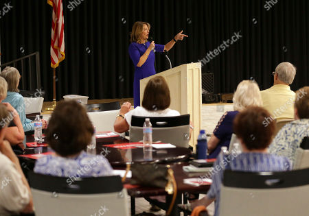 U.S. Senatorial candidate Kelli Ward speaks to volunteers and voters during the Sun Lakes Republican Club meeting in Sun Lakes, Ariz. Shortly before the raffle for a handgun, top Arizona Republicans gave a warning to the crowd gathered at a conservative group's meeting in a retirement community at the edge of Phoenix's sprawl: The Democrats are coming