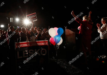 """Stock Photo of U.S. Rep. Debbie Lesko, R-Ariz., right, celebrates her congressional win at her home in Peoria, Ariz. Democrats hope that a primary between three Republicans helps them get a shot at an open U.S. Senate seat that could determine which party controls the chamber. Republicans know they have their work cut out for them. """"I think it's going to be a force that we're going to have to reckon with, for sure,"""" said former Gov. Jan Brewer, who campaigned for Lesko, whose narrow special election win shocked her party"""