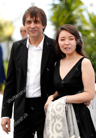 Russian director Sergey Dvortsevoy (L) and actress Samal Yeslyamova pose during the photocall for 'Ayka' at the 71st annual Cannes Film Festival, in Cannes, France, 18 May 2018. The movie is presented in the Official Competition of the festival which runs from 08 to 19 May.