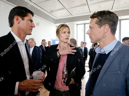 Stock Image of (L-R) Sport manager Marcus Hoefl, German fencer Britta Heidemann and German TV presenter Alexander Bommes talk during BILD100 Sport event in Berlin, Germany, 18 May 2018. The event invites 100 of the most important and influential German and International personalities of Politics, Economics and Sport.
