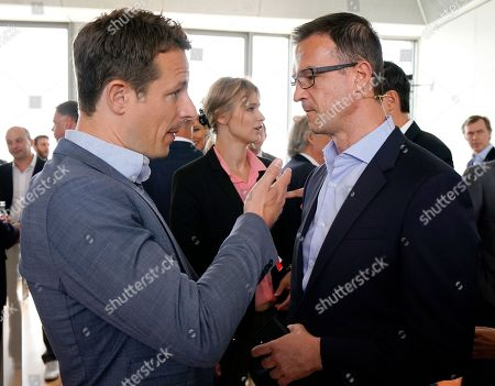 German TV presenter Alexander Bommes (L) and Eintracht Frankfurt's sports director, Fredi Bobic, talk during BILD100 Sport event in Berlin, Germany, 18 May 2018. The event invites 100 of the most important and influential German and International personalities of Politics, Economics and Sport.