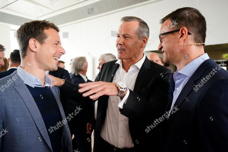 (L-R) German TV presenter Alexander Bommes, German Boxer Henry Maske and Eintracht Frankfurt's sports director, Fredi Bobic, talk during BILD100 Sport event in Berlin, Germany, 18 May 2018. The event invites 100 of the most important and influential German and International personalities of Politics, Economics and Sport.