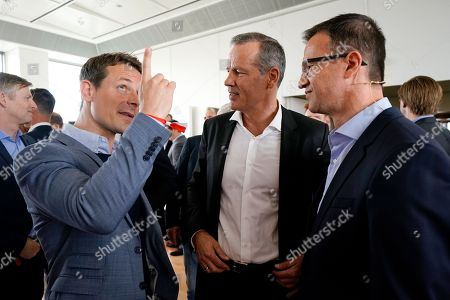 Stock Photo of (L-R) German TV presenter Alexander Bommes, German Boxer Henry Maske and Eintracht Frankfurt's sports director, Fredi Bobic, talk during BILD100 Sport event in Berlin, Germany, 18 May 2018. The event invites 100 of the most important and influential German and International personalities of Politics, Economics and Sport.