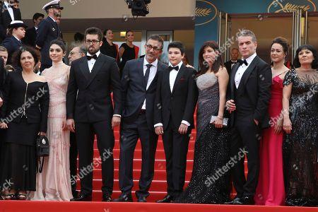 Zeynep Ozbatur Atakan, Hazar Erguclu, Dogu Demirkol, Nuri Bilge Ceylan, Ayaz Ceylan, Ebru Ceylan, Murat Cemcir, Bennu Yildirimlar, Ozay Fech. Producer Zeynep Ozbatur Atakan, from left actress Hazar Erguclu, actor Dogu Demirkol, director Nuri Bilge Ceylan, actor Ayaz Ceylan, writer Ebru Ceylan, actor Murat Cemcir, actress Bennu Yildirimlar and actress Ozay Fecht pose for photographers upon arrival at the premiere of the film 'The Wild Pear Tree' at the 71st international film festival, Cannes, southern France