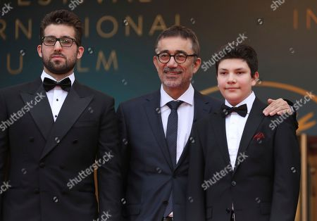 Dogu Demirkol, Nuri Bilge Ceylan, Ayaz Ceylan. Actor Dogu Demirkol, from left, director Nuri Bilge Ceylan, and actor Ayaz Ceylan pose for photographers upon arrival at the premiere of the film 'The Wild Pear Tree' at the 71st international film festival, Cannes, southern France