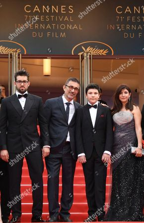 Dogu Demirkol, Nuri Bilge Ceylan, Ayaz Ceylan, Ebru Ceylan. Actor Dogu Demirkol, from left, director Nuri Bilge Ceylan, actor Ayaz Ceylan and writer Ebru Ceylan pose for photographers upon arrival at the premiere of the film 'The Wild Pear Tree' at the 71st international film festival, Cannes, southern France