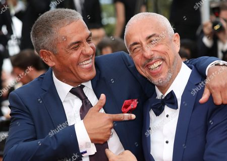 Actor Samy Naceri, left, poses for photographers upon arrival at the premiere of the film 'The Wild Pear Tree' at the 71st international film festival, Cannes, southern France