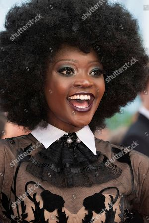 Stock Photo of Model Miriam Odemba poses for photographers upon arrival at the premiere of the film 'The Wild Pear Tree' at the 71st international film festival, Cannes, southern France