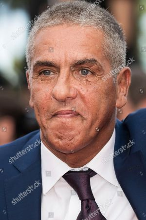 Actor Samy Naceri poses for photographers upon arrival at the premiere of the film 'The Wild Pear Tree' at the 71st international film festival, Cannes, southern France