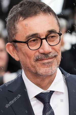 Director Nuri Bilge Ceylan poses for photographers upon arrival at the premiere of the film 'The Wild Pear Tree' at the 71st international film festival, Cannes, southern France
