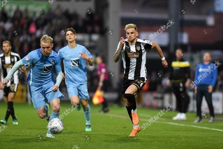 Notts County defender Daniel Jones (23) and Coventry City's Jack Grimmer (2) during the EFL Sky Bet League 2 match between Notts County and Coventry City at Meadow Lane, Nottingham. Picture by Jon Hobley