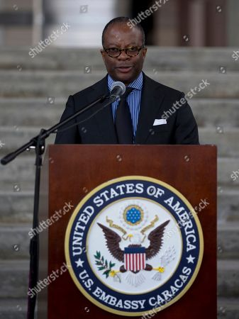 United States Chargé d'Affaires Todd Robinson speaks during a briefing at the Embassy building in Caracas, Venezuela, . Robinson said, reading a statement, that they are closely following the events of the Barquisimeto prison where Americans are held, but did not offer details