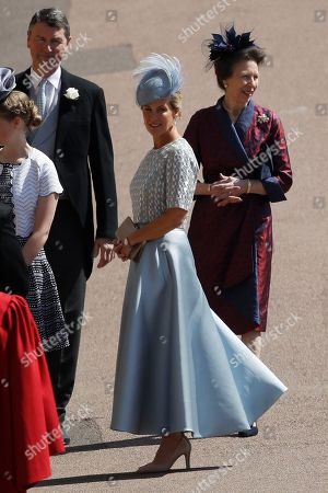 Britain's Sophie, Countess of Wessex, center, Britain's Princess Anne, right, and Timothy Laurence arrive for the wedding ceremony of Prince Harry and Meghan Markle at St. George's Chapel in Windsor Castle in Windsor, near London, England