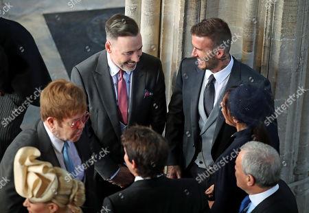 David Beckham and Victoria Beckham talk with Sir Elton John and David Furnish