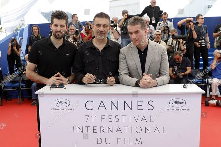 (L-R) Actor Dogu Demirkol, director Nuri Bilge Ceylan, and Murat Cemcir pose during the photocall for 'The Wild Pear Tree  (Ahlat Agaci)' at the 71st annual Cannes Film Festival, in Cannes, France, 19 May 2018. The movie is presented in the Official Competition of the festival which runs from 08 to 19 May.