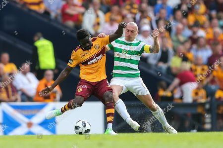 Gael Bigirimana (#5) of Motherwell and Scott Brown (#8) of Celtic contest the ball during the William Hill Scottish Cup match between Celtic and Motherwell at Hampden Park, Glasgow. Picture by Craig Doyle