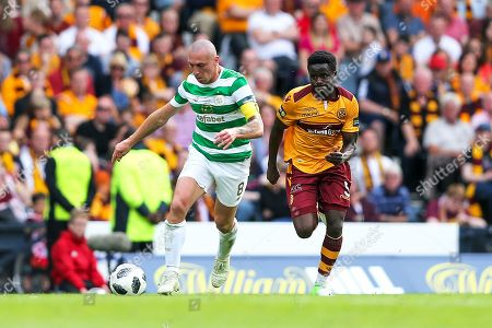 Scott Brown (#8) of Celtic dribbles the ball away from Gael Bigirimana (#5) of Motherwell during the William Hill Scottish Cup match between Celtic and Motherwell at Hampden Park, Glasgow. Picture by Craig Doyle