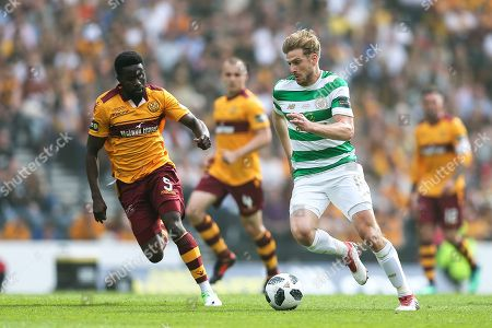Stuart Armstrong (#14) of Celtic takes on Gael Bigirimana (#5) of Motherwell during the William Hill Scottish Cup match between Celtic and Motherwell at Hampden Park, Glasgow. Picture by Craig Doyle