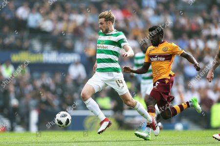 Stuart Armstrong (#14) of Celtic bursts through the middle of the pitch followed by Gael Bigirimana (#5) of Motherwell during the William Hill Scottish Cup match between Celtic and Motherwell at Hampden Park, Glasgow. Picture by Craig Doyle