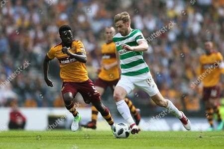 Stuart Armstrong (#14) of Celtic drives the ball forward psued by Gael Bigirimana (#5) of Motherwell during the William Hill Scottish Cup match between Celtic and Motherwell at Hampden Park, Glasgow. Picture by Craig Doyle