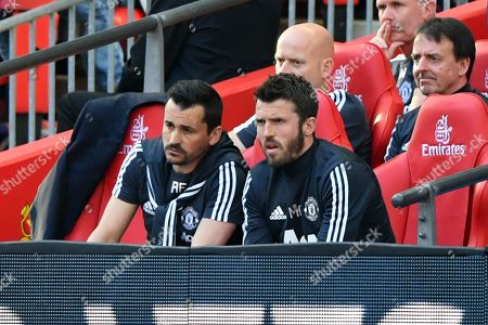 Michael Carrick and Rui Faria on the bench
