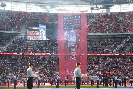 A banner is displayed in the memory of Ray Wilkins who passed away