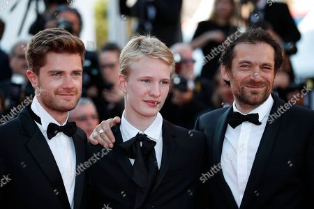Stock Image of Belgian actor Victor Polster (C), Belgian director Lukas Dhont (L) and Belgian actor Arieh Worthalter arrive for the screening of 'The Man who Killed Dom Quixote' and Closing Awards Ceremony of the 71st annual Cannes Film Festival, in Cannes, France, 19 May 2018.