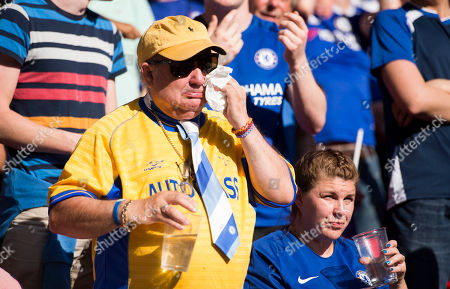 Emotional chelsea fan as tributes are paid to Ray Wilkins.