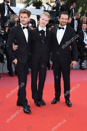 Director Lukas Dhont, from left, actors Victor Polster and Arieh Worthalter pose for photographers upon arrival at the premiere of the film 'The Man Who Killed Don Quixote' and the closing ceremony of the 71st international film festival, Cannes, southern France