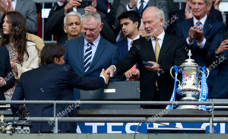 Tim Clark President of Emirates  presents Chelsea Manager Antonio Conte with his winners' medal