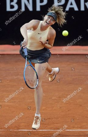 Stock Photo of Russia's Maria Sharapova serves the ball to Romania's Simone Halep, during their semifinal match at the Italian Open tennis tournament in Rome