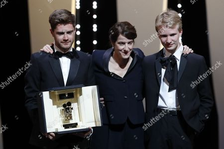 Lukas Dhont (L) poses with Ursula Meier and Victor Polster  after winning the Camera d'Or jury prize for the movie 'Girl' during the Closing Awards Ceremony of the 71st Cannes Film Festival, in Cannes, France, 19 may 2018.
