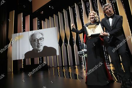 Cate Blanchett, Fabrice Aragno. Cinematographer Fabrice Aragno, right, holds the special Palme d'Or award on behalf of director Jean-Luc Godard, on screen, for his film 'The Image Book', which was presented by jury president Cate Blanchett, second from right, during the closing ceremony of the 71st international film festival, Cannes, southern France